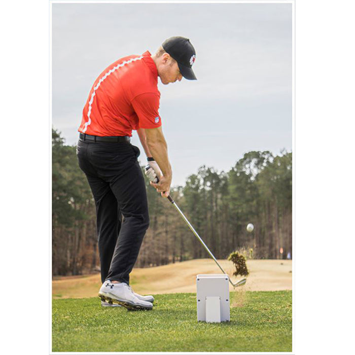 Golfer playing on the course using Ernest Sports ES14 Pro Golf Launch Monitor