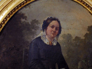 Small oval gilt frame of old lady sitting