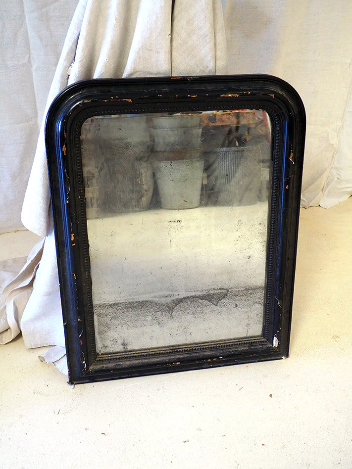 French Antiqued mirror in black timber frame