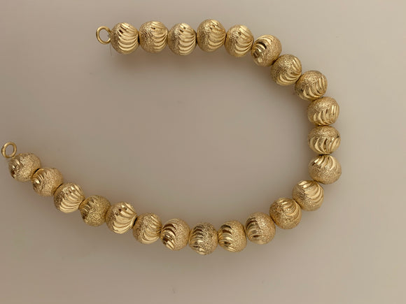 1 Strand of Brushed Finish Fancy Shiny Round Gold Finish Beads , E-coated Beads. Bead Size is: 10mm NO-86