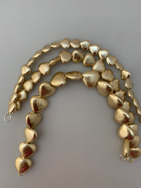 1 Strand of Heart shape  Brushed Finish   Beads, Gold finish and Silver Plated  E-coated (about 13to 22  Beads in strand ))