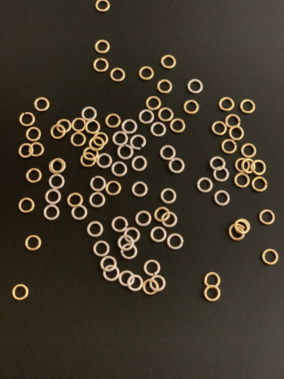 A Pack Of  Open Jump Rings in 3 Colors AND 6 Sizes: (Gold Finish, Silver Plated And Gunmetal Plated) Open Jump Rings, E-coated.