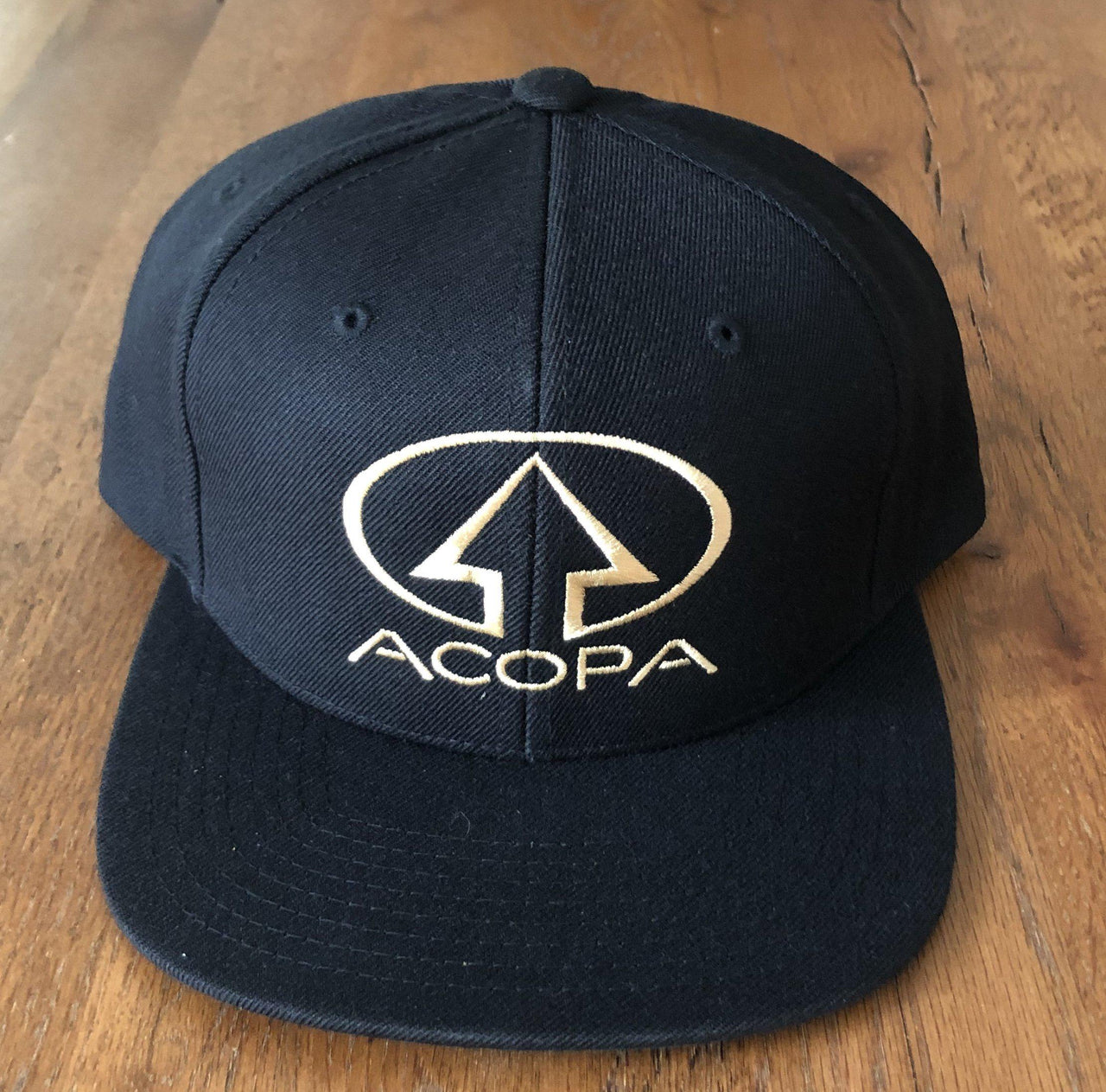 Black Acopa Hat with Gold Embroidered Logo