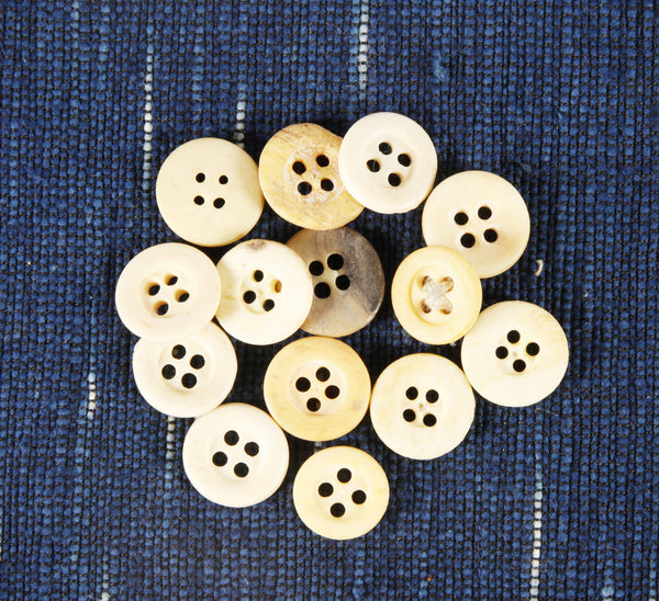4 hole Civil War era bone buttons with rim small