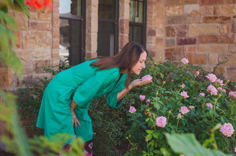 woman smelling the roses