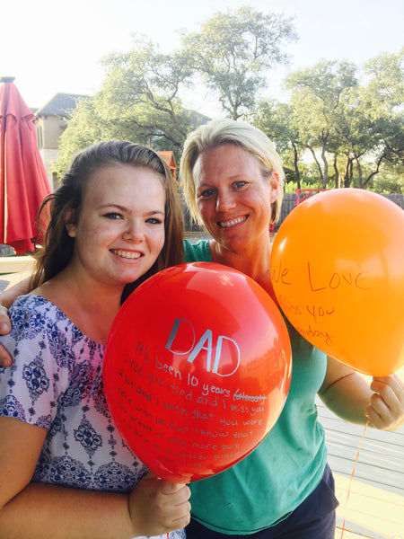 Recovery Brobe creator Allison Schickel with young woman and tribute balloons