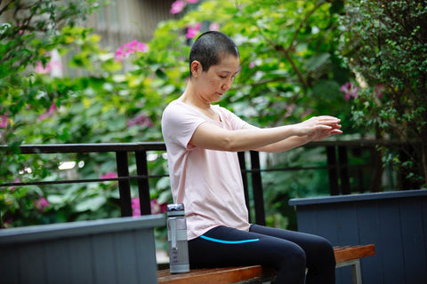 woman exercising on bench