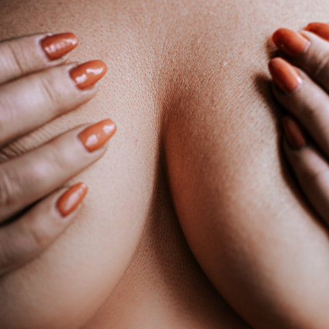 woman holding breast