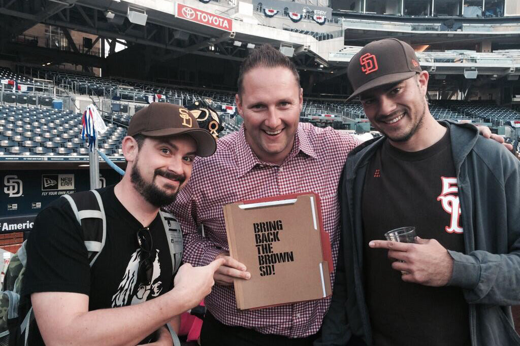 Handing 'Bring Back The Brown' Signatures to Padres CMO Wayne Partello