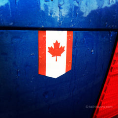 Flag of Canada car sticker on a VW Jetta in the rain