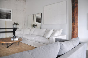 Modular sofa light coloured linen, floor standing mirrors and Natural timber coffee table, artwrok