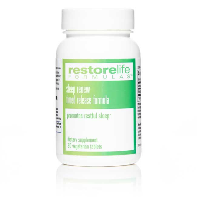 White bottle with green label of sleep renew supplement