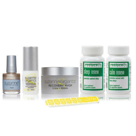 6-Piece Holiday Survival bundle including shiny gold nail polish, radiance oil moisturizer, recovery face mask bottle, a yellow nail file, a bottle of sleep renew, and a bottle of calm renew supplements.