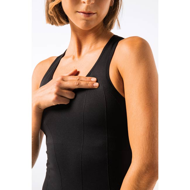 Women wearing black tank and pressing point