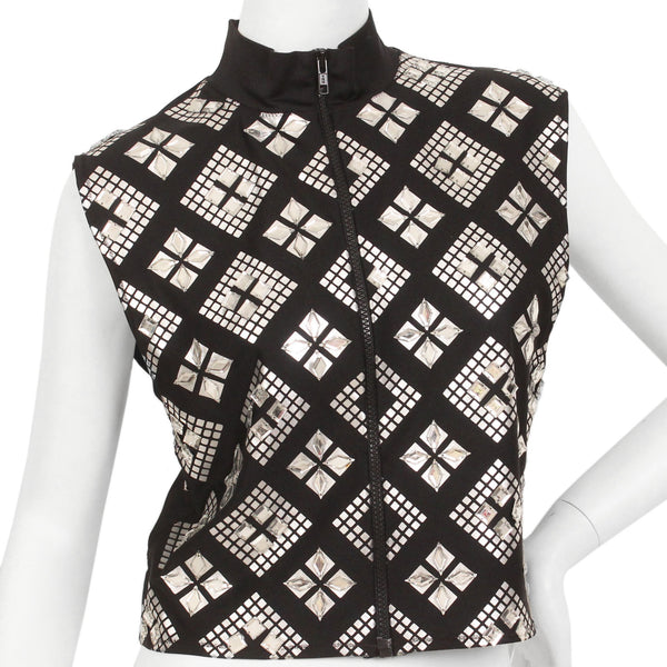 Black, sleeveless, zip-up, mock-neck top with a silver, graphic print with mirrored embellishments.