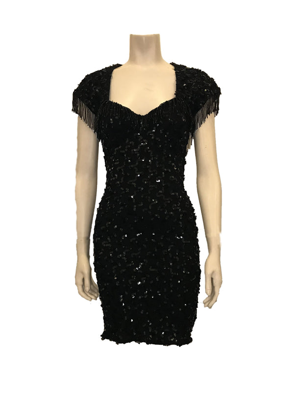 Black, lace, stretch-knit, knee-length dress with short sleeves, sequin beads throughout, and fringe-beading on sleeves.