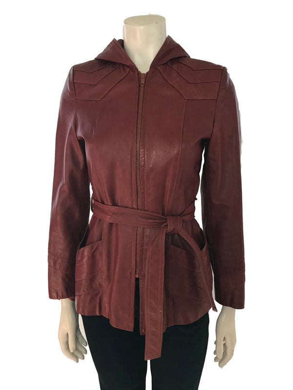 Hip length burgundy leather jacket with hood, front zipper, matching belt and 2 front pockets