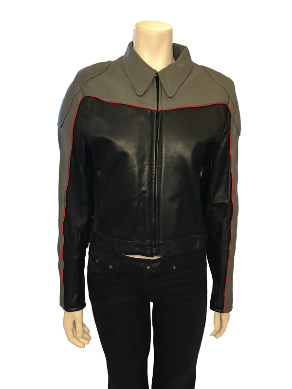 Grey and black leather motorcycle style jacket with front zipper and two zippered pockets. sleeves are black in front and grey on back, yoke of jacket is grey. Trimmed in red leather piping