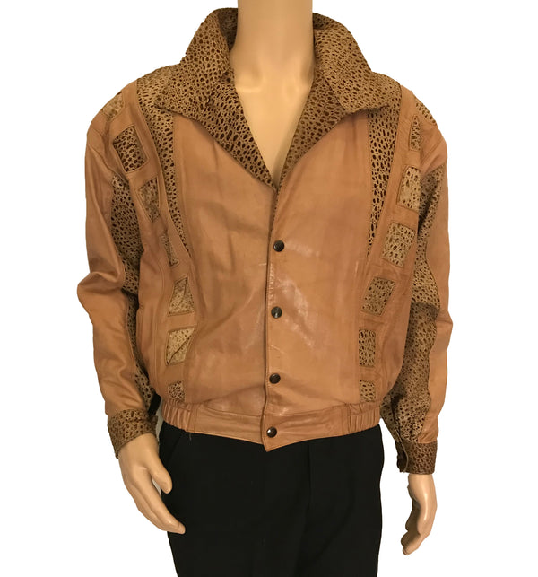 Tan leather bomber style jacket with inserts of texturized leather in a snake pattern. Banded bottom and cuffs with four snaps up front.