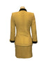 yellow, wool, two-piece jacket & skirt with black trim on four front pockets and on collar and cuffs. gold buttons down front.