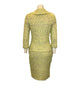 Full length back view of mannequin wearing a St John Couture lime green tweed skirt suit.