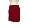 Full length back view of red Geoffrey Beene pencil skirt with zipper up the center.