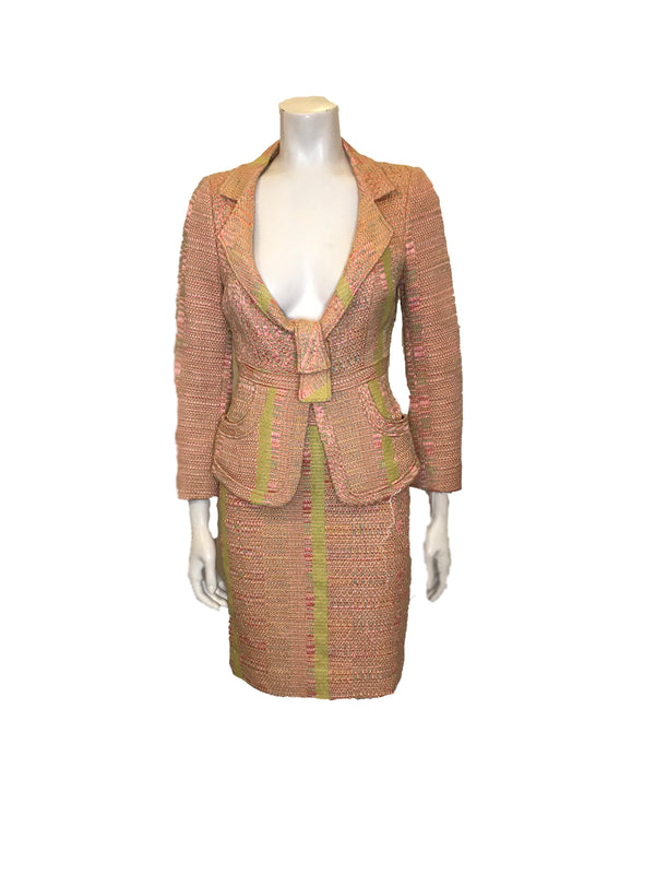 Full front view of mannequin wearing textured pink and green knit blazer and skirt set with abstract vertical stripes by Christian Lacroix.