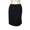 Back view of a simple black pencil skirt with a zipper up the center.