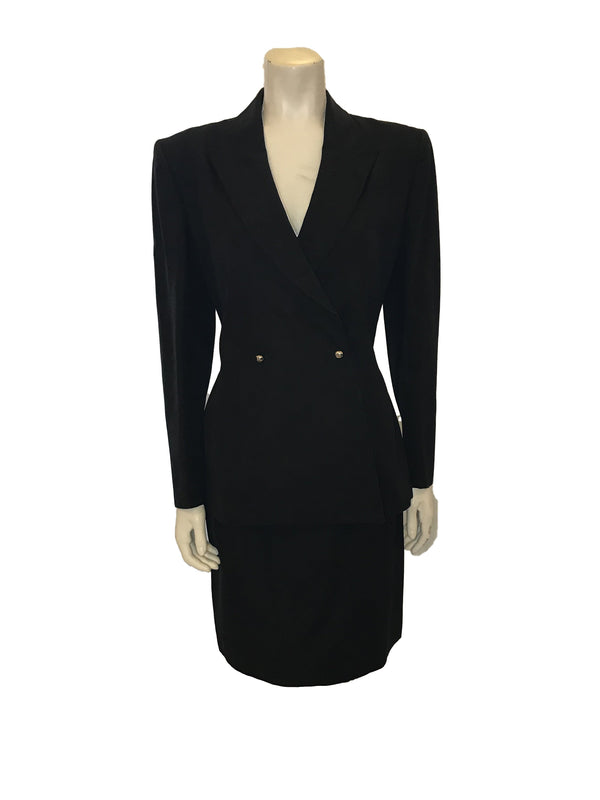 Front full view of mannequin wearing a black 1980s Thierry Mugler two piece blazer and skirt set.