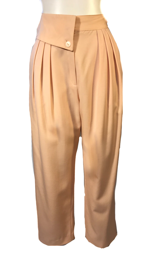 Front view of apricot colored womens trousers with a foldover waist band and front pleats