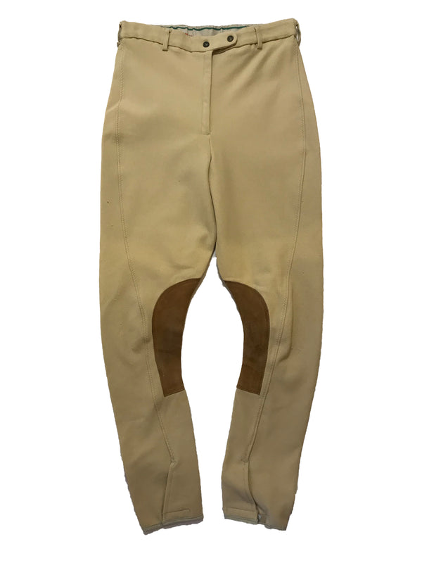 Stretchy, beige breeches with curved seams and brown, suede patches on the inner-knees.