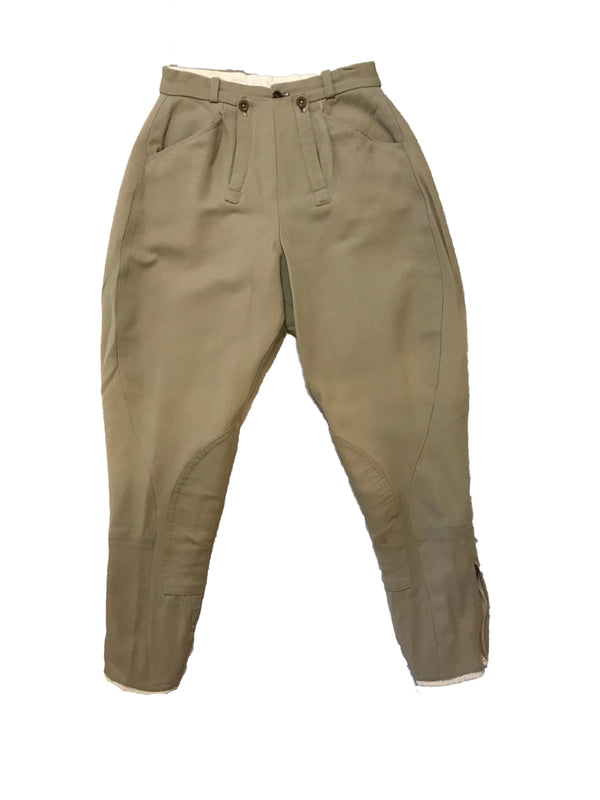 Stretchy, khaki jodhpurs with patches on the inner-knees. Three-button waistband closure.