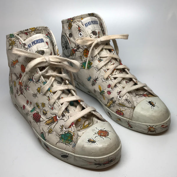 White high top sneakers with an all over bug print by Kiki Picasso x Slugger