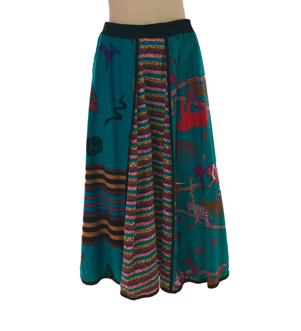 Front view of midi skirt with a mixed print featuring animal prints, animal shapes, and stripes in each panel framed by black piping.