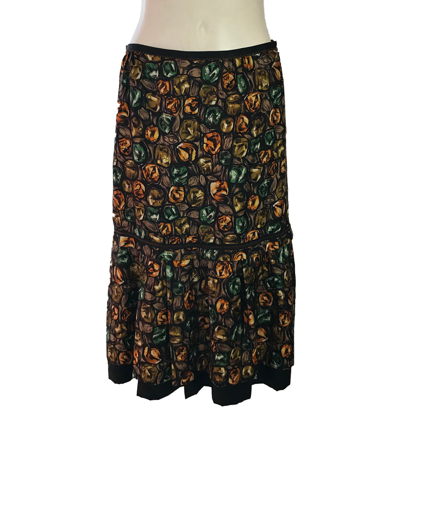 Front view of Easton Pearson silk skirt with a green, orange, and brown gemstone print..
