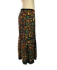Side view of Easton Pearson silk skirt with a green, orange, and brown gemstone print.