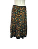Back view of Easton Pearson silk skirt with a green, orange, and brown gemstone print.