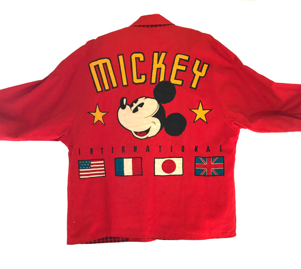 "Red blazer reading ""MICKEY INTERNATIONAL"" with a large patch of Mickey Mouse's face"