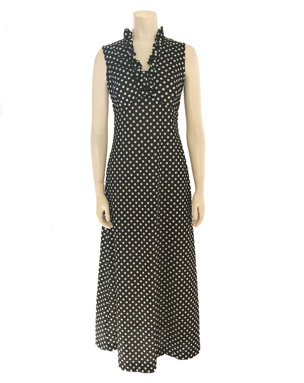Black & white polka-dot, empire-waist, maxi dress with ruffled v-neck.