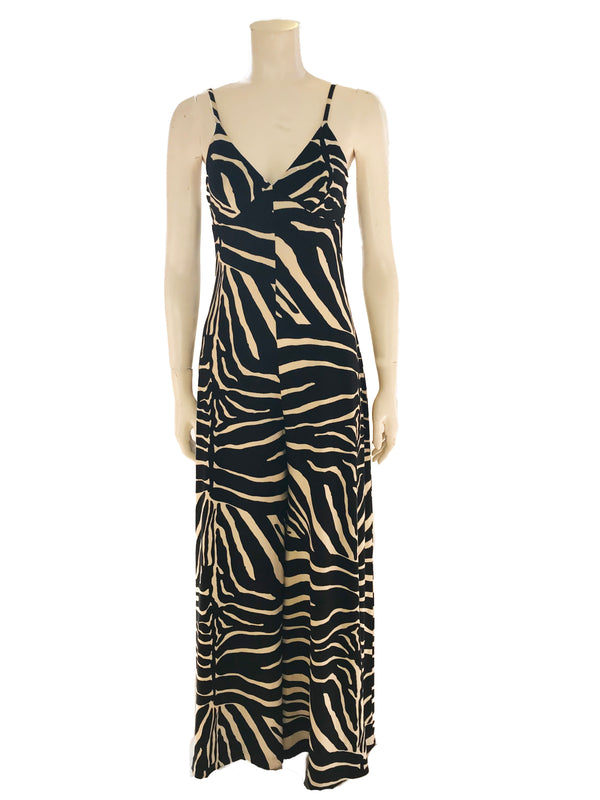 Black & white, zebra-print jumpsuit with spaghetti-straps, v-neck, and wide-legs.