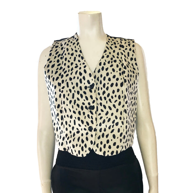 Black & white, dalmatian-spotted, faux-fur, button-up vest. Black back.
