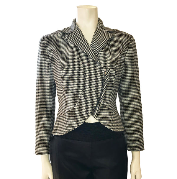 Black & white houndstooth, long-sleeve jacket with asymmetrical front-zipper. Oversized button on back.