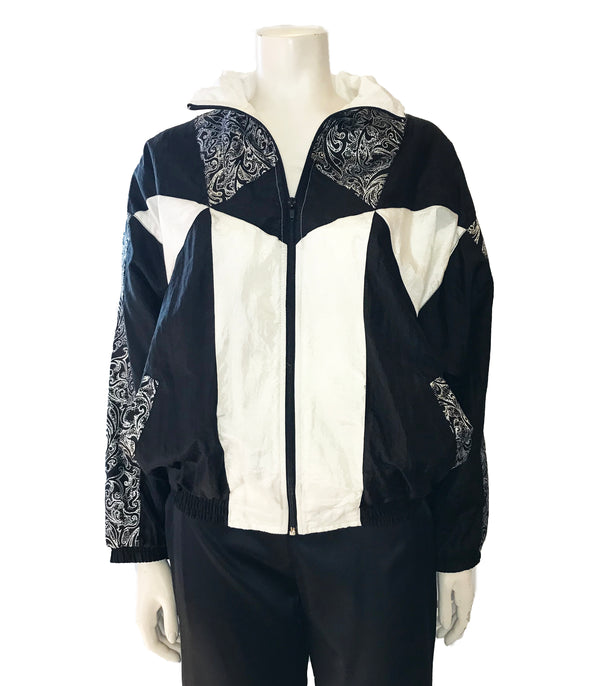 Black & white, colorblock, zip-front windbreaker with silver, paisley-print accents.