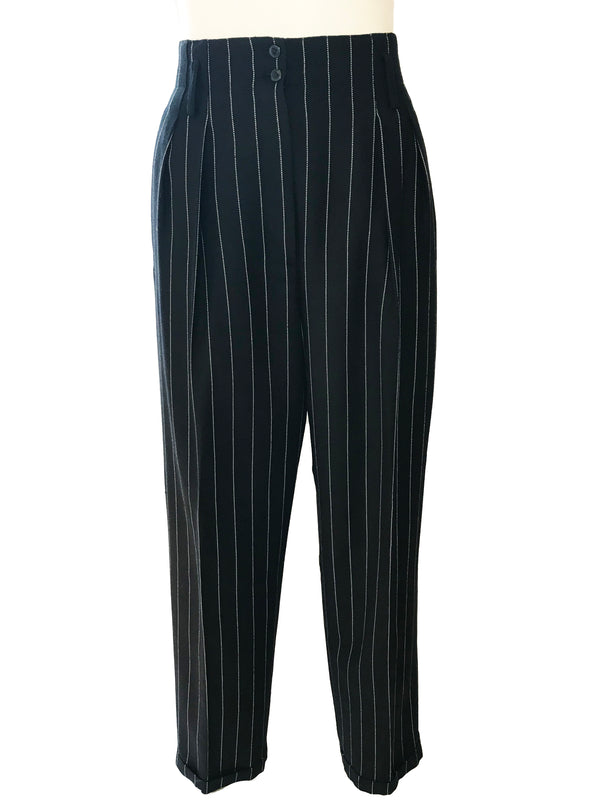 Black & white, pinstripe, high-waisted, double-pleated, tapered trousers with front zipper.