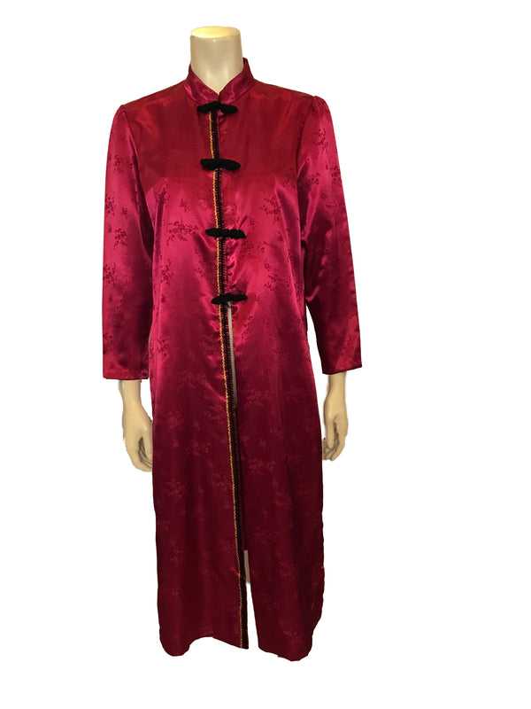 (Front View) Tangzhuang inspired magenta floral print satin duster featuring a mandarin collar, long sleeves, and four black frog closure buttons at the front.