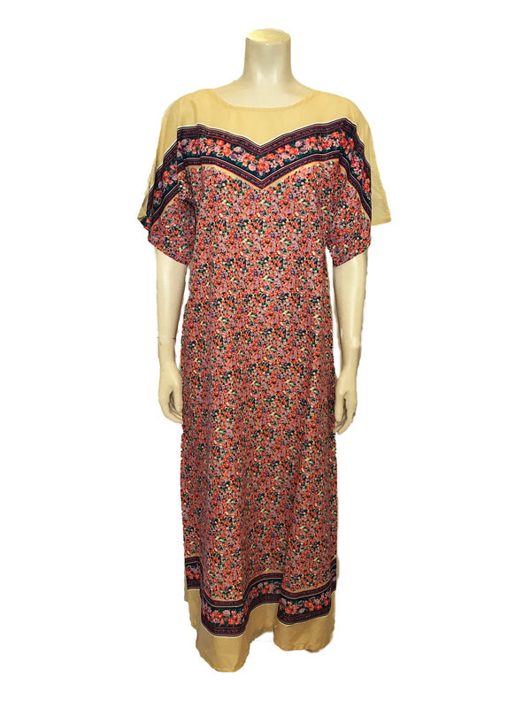 (Front View)  Beige and Floral Print Kaftan featuring a round neck and short dolman sleeves along with striped bands of flowers at the chest and along the bottom hem.