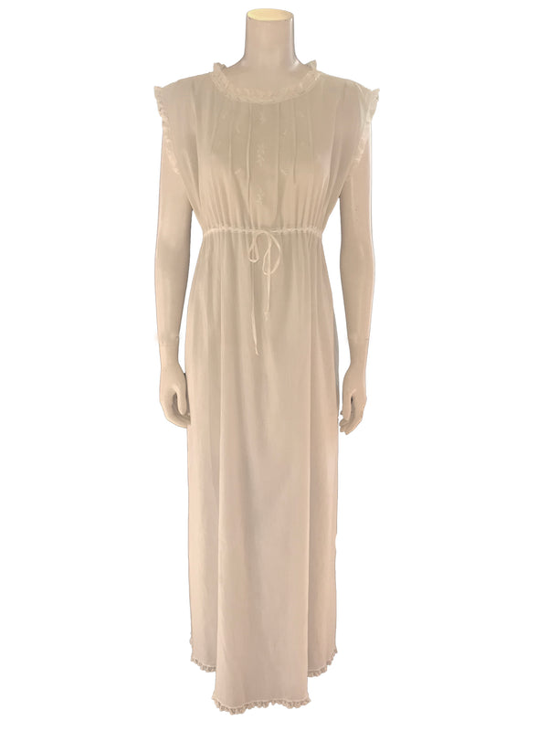 (Front View) Maxi length lounge dress crafted in a ultra pale pastel green, semi sheer cotton gauze featuring a high round neck with pintuck detailing, floral embroidery, also ribbon and lace drawstring waist.