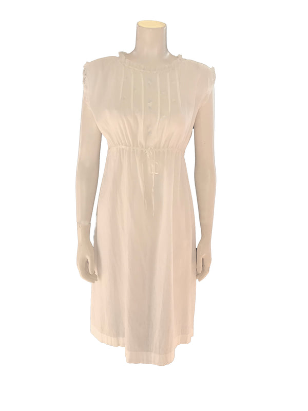 (Front view) A semi sheer cotton gauze knee length lounge dress featuring a high round neck and floral embroidery at the chest along with a ribbon and lace drawstring at waist.