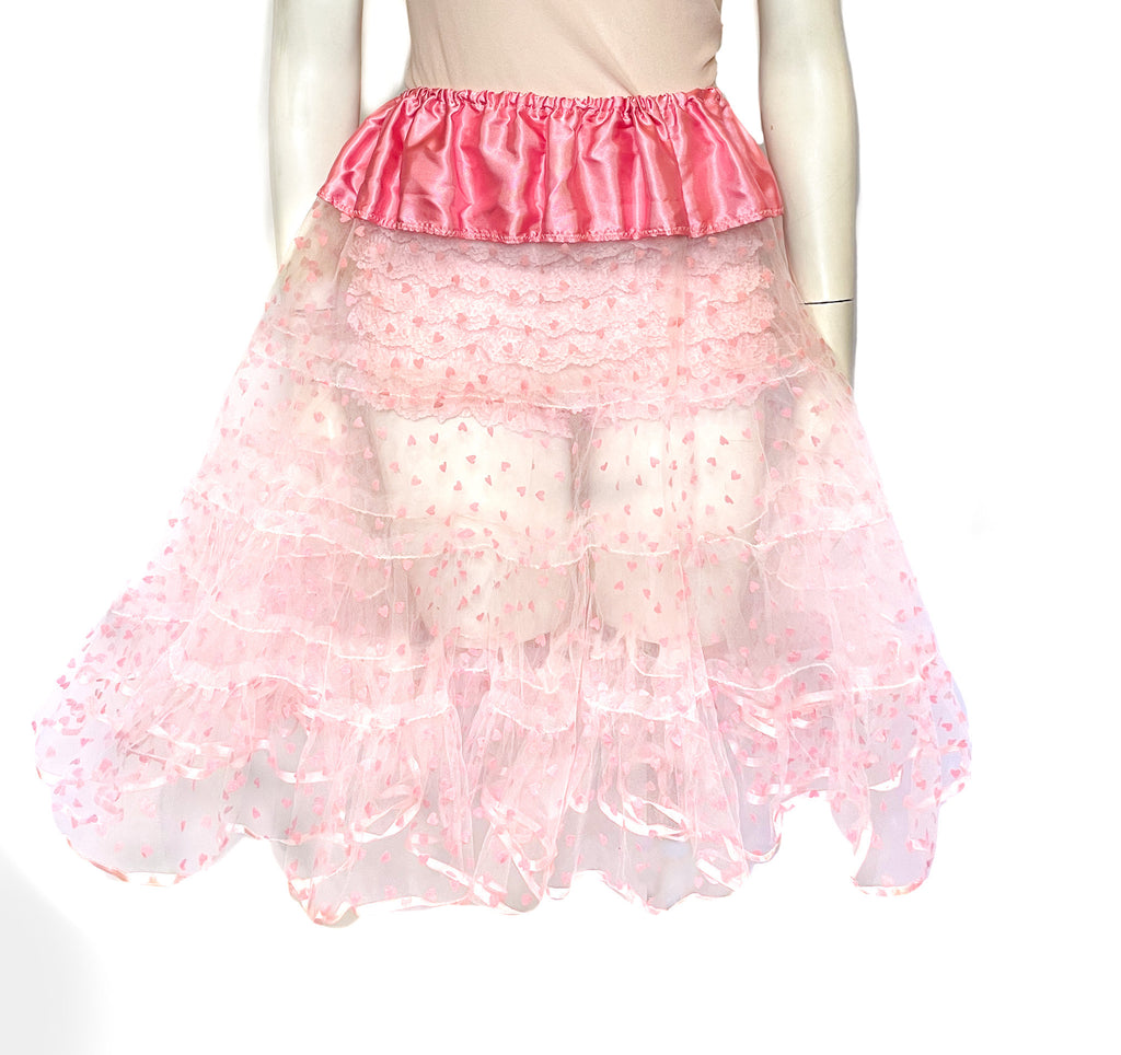 Light pink, sheer, tulle crinoline with all-over, tiny, pink, velvet hearts. Pink satin waistband.