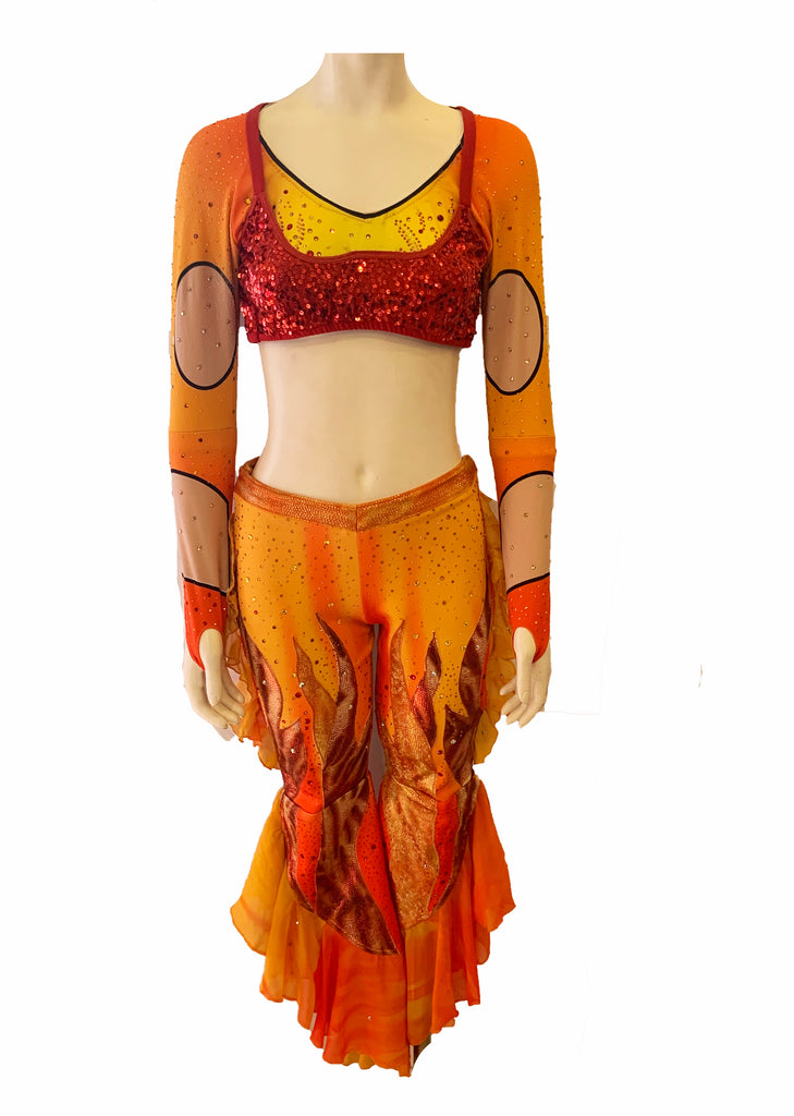 2 piece set featuring a long sleeve crop top and cropped stretch  dance pants with rhinestones, orange and yellow color block and flame detailing